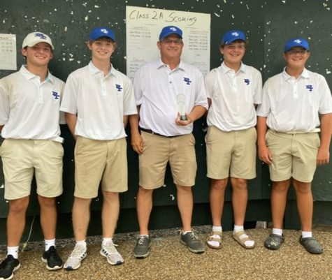 Brayden Stroud, Jack Butts, Coach Brett Larmier, Whitson McNeil and Payton Toon celebrate at the 2A regional championship at the Madisonville Country Club.